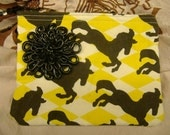 black and yellow horse purse with detachable brooch