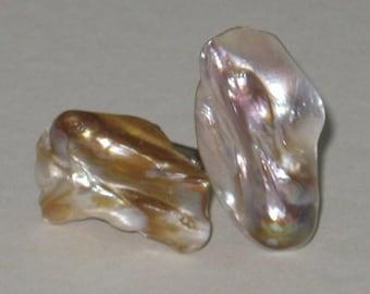 Pearls encased in albacore shell cufflinks