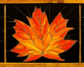 8x30 inch stained glass mosaic of three maple leaves.