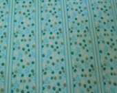Green polka dot\/striped snuggle fabric