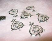 6 pieces heart shape filigree center pieces in silvertone