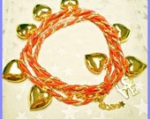 Love heart coral and gold wrap around charm Bracelet