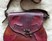 Handcrafted Leather Bag featuring red maple leaves