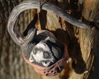 Sleeping ferret walnut ornament