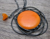 Cosmic ... fused glass and metalwork pendant in electric orange