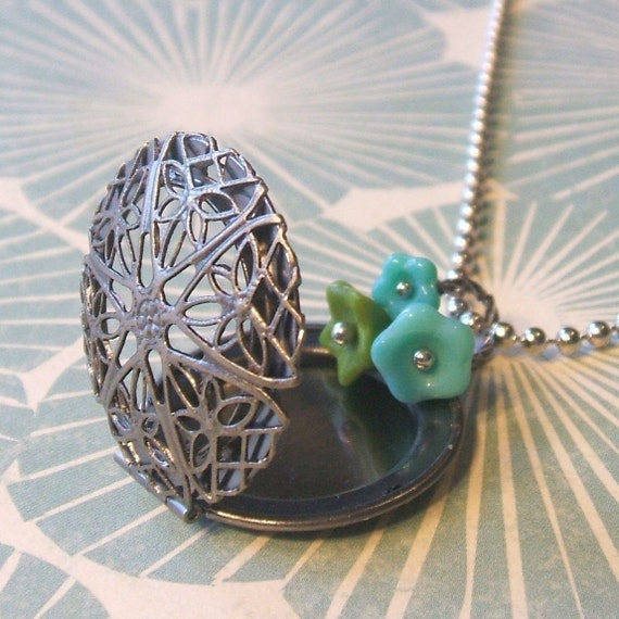 Tangled.  A Locket Necklace