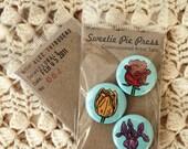 florals button set by alec thibodeau