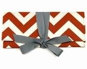 Clutch in burnt orange chevron stripe with gray. The ALEXIS Clutch.