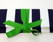 Navy stripe clutch with a green bow. The ALEXIS Clutch.