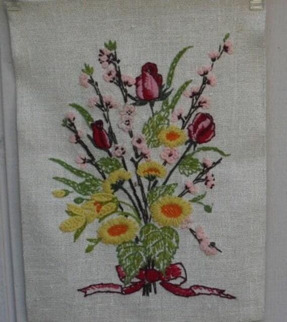 Vintage - crewel embroidered flower wall art in orange and brown vase