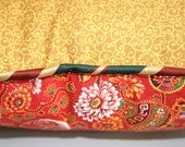 hand sewn pillow in red and yellow