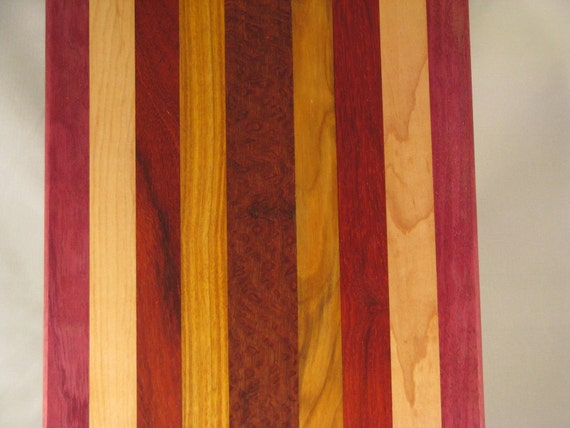 cutting board trivet chopping block made from many different  woods 18 x 8.5 with purpleheart, maple, paduck, canary wood and lacewood