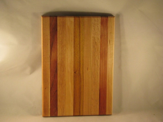 handmade in Cleveland 12 by 8.5 cutting board chopping block trivet butcher block cheese board .cherry, jatoba, oak, and cannary wood