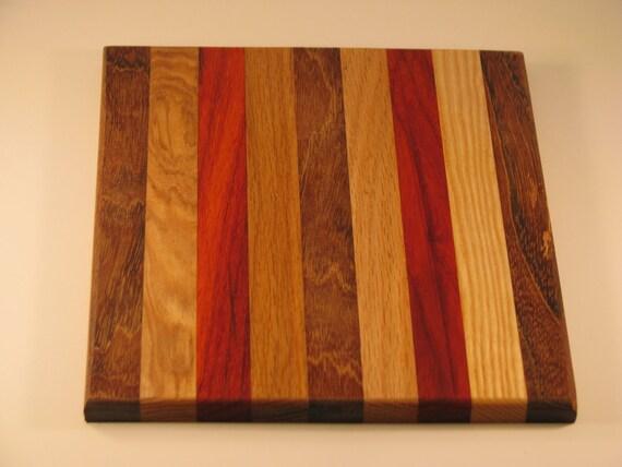 "cutting board/chopping block made of many different woods.10 x 8.5"" with jatoba , jatoba, ash, paduck, oak and jatoba center"