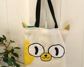 Cake the Cat hand bag purse tote from the TV show Adventure Time. 12 x 14 x 3 inch reversible from gender swap episode of Jake the dog