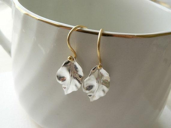 silver leaf earrings - delicate modern jewelry by windowsill