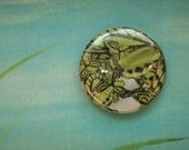 green butterfly patterned one inch button
