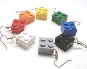 the square pair that dangles - earrings made with 2x2 toy blocks - in red, orange, yellow, green, blue, black, gray and white