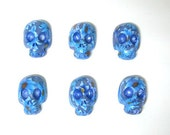Dia De Los Muertos polymer clay floral skulls beads in blues