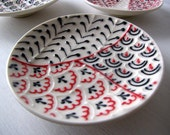 Single Small Black and Red Dish
