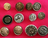 Buttons - 12 x shields, crests, anchors, heads - silver, copper and bronze coloured plastic and metal buttons.