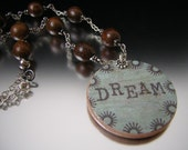 Dream stamped wood and sterling silver wire wrapped pendant necklace by Lori Ramotar The Royal Bead