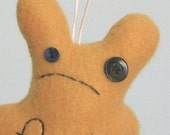 small hangable unhappy gold f.ck bunny (mature)