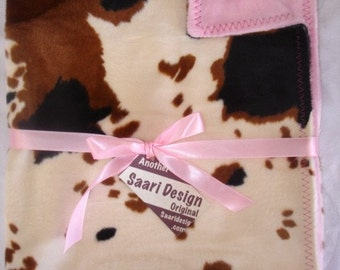 Cowgirl or Cowboy country western boutique baby blanket  cow spots
