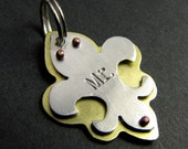 brass and aluminum fleur de lis pet tag