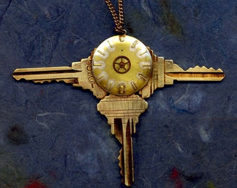 HANDMADE JEWELRY PENDANT...Trinity....handcrafted welded steampunk pendant which features 3 vintage keys and vintage watch face.