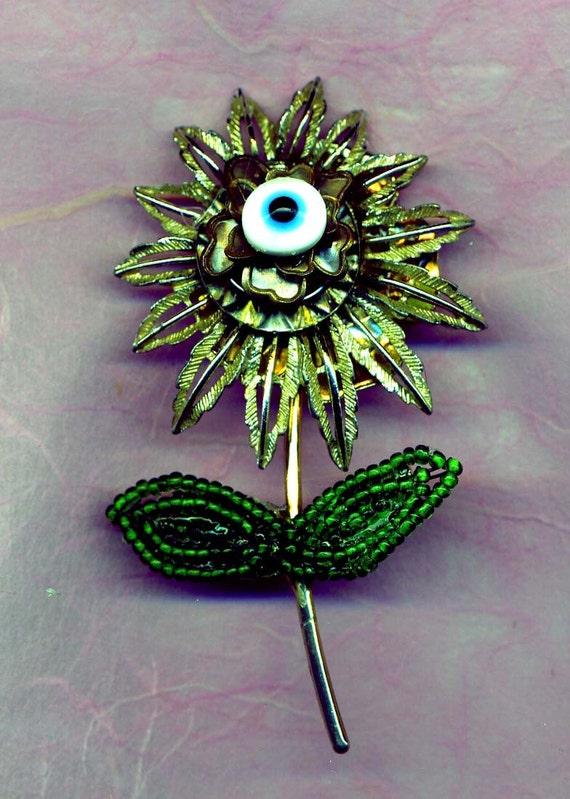 HANDMADE JEWELRY BROOCH...Eye Blossom....dramatic handmade brooch with a protective eye charm..good luck brooch.