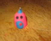 pink and blue monster charm