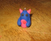 blue and hot pink monster charm