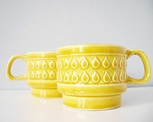 Two vintage cups stacking ceramic raindrop pattern - caramel yellow mugs with rain drops