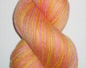Hand Dyed Orange Yellow and Pink Superwash Merino Bamboo Sock Yarn