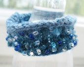 Handknit beaded bangle bracelet in blues