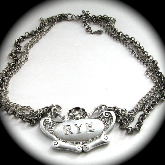 RYE Vintage LIQUOR LABEL necklace STERLING plated components BAROQUE SCROLL and SHELL Design
