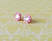 Pink flower stud earrings with Swarovski crystal center