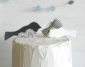 Bird wedding cake toppers in charcoal and white with bowtie and doily