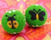 yellow ladybird and black butterfly stud earrings