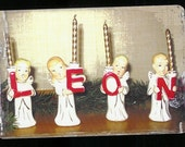 Joyeux Leon,  Five Irreverent Christmas Postcards