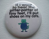 pitter patter of feet...shoes on my cat...button