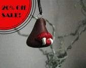 A vampire's chocolate Kiss- Hershey's style Kiss pendant on hemp cord