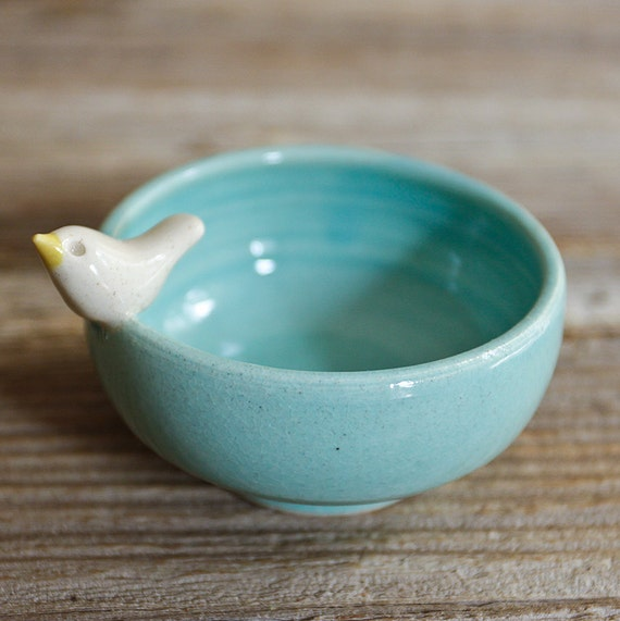 Sweet Little White Bird on an Aqua Bowl