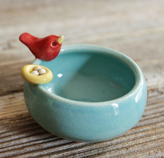 Sweet Little Red Bird on an Aqua Bowl with Nest