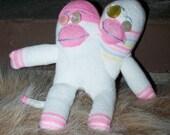 two headed baby sock monkey