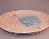 blue and orange serving plate with fly swatter and flies motif