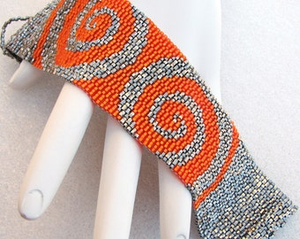 A Hex on Mirrored Orange Swirls on Steel Peyote Cuff Bracelet (2448)