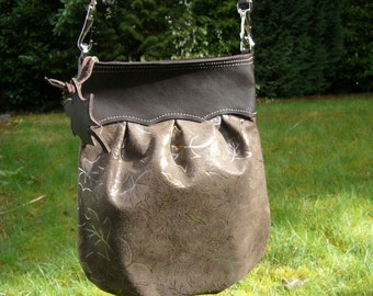 Embossed & foiled leaves on brown pleated leather purse