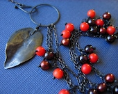 winterberry tart- coral and handformed, oxidized sterling leaf- asymmetrical necklace